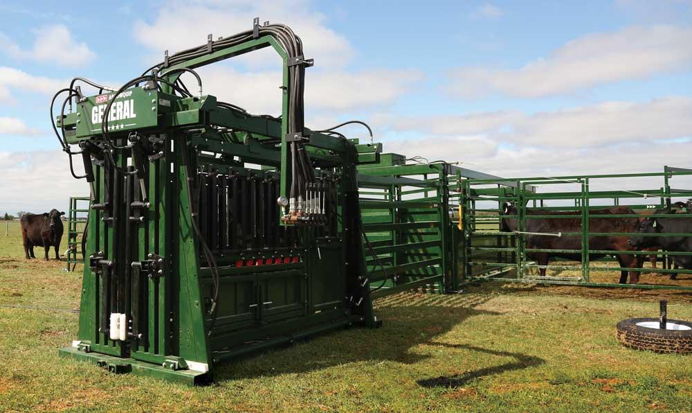 hydraulic cattle squeeze chute in field